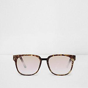 Bruine zonnebril met montuur met schildpadeffect en doorzichtige glazen