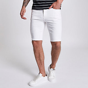 White ripped Sid skinny denim shorts
