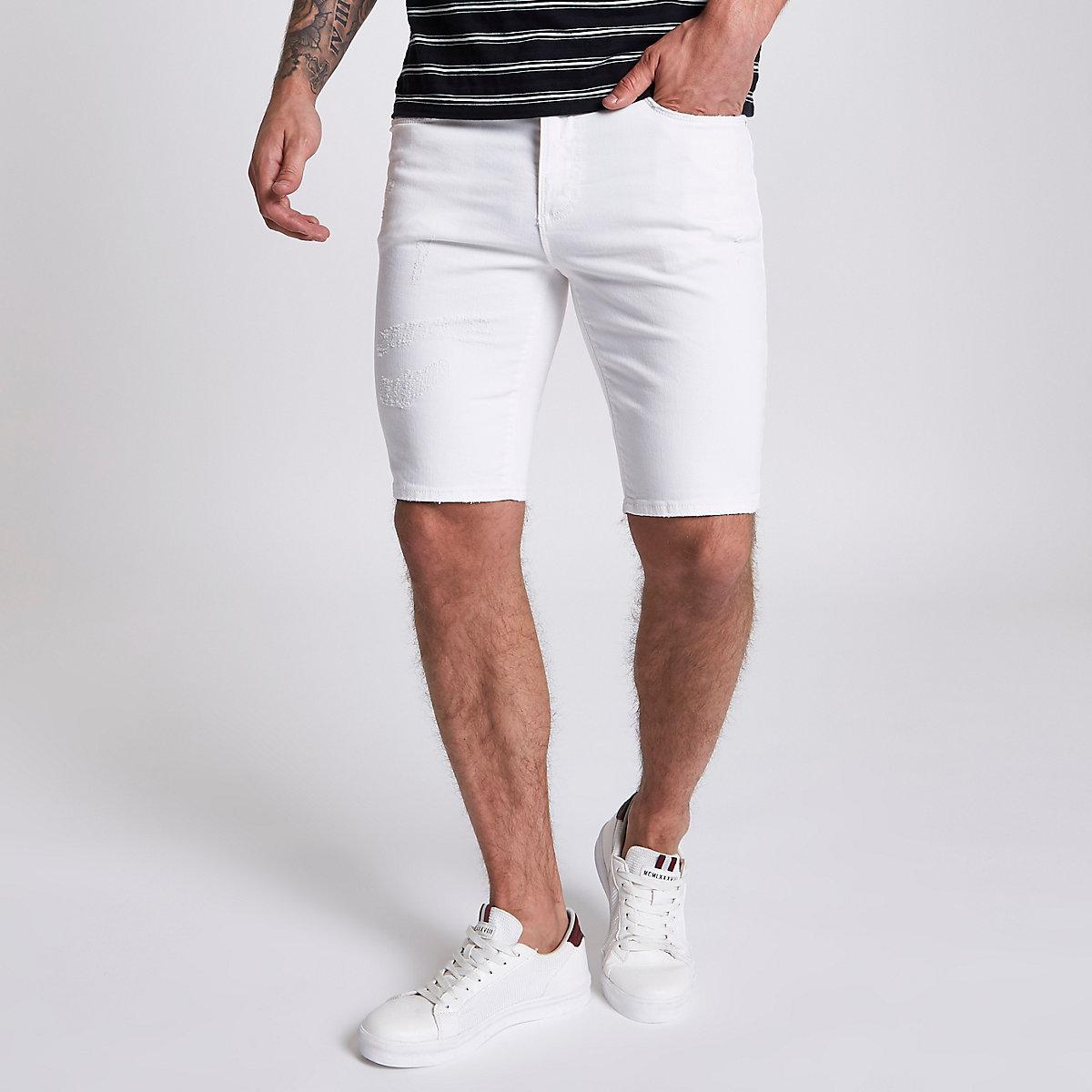 White ripped Sid skinny denim shorts