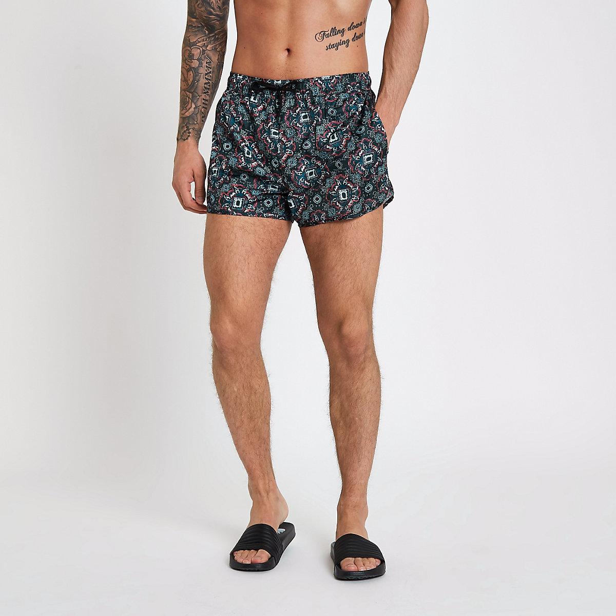 Green tapestry print short swim trunks