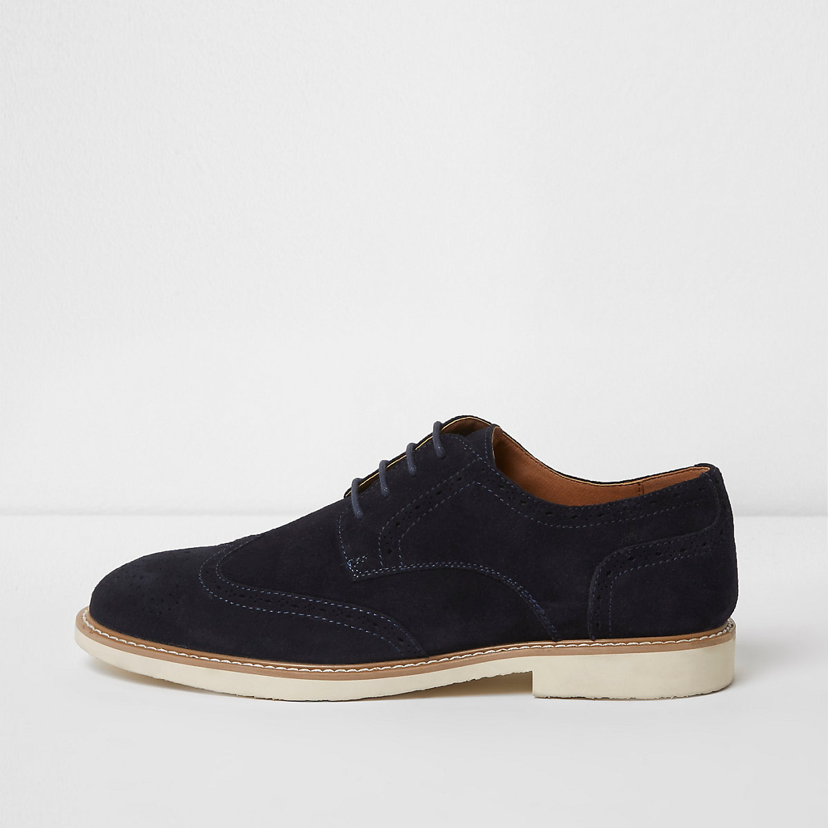 Navy suede white sole brogues