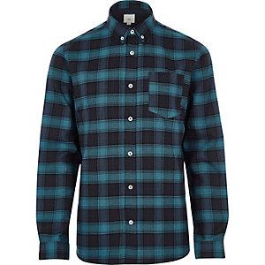Chemise casual à carreaux bleue boutonnée