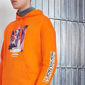 """Blood Brother – Oranger Hoodie mit """"Caution""""-Aufdruck"""
