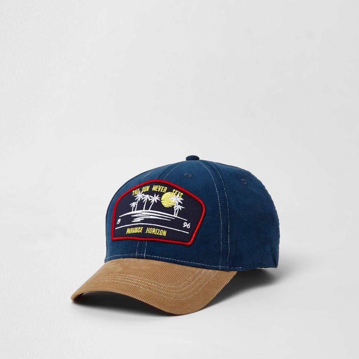 Casquette de baseball en velours côtelé bleu avec écusson « Paradise »