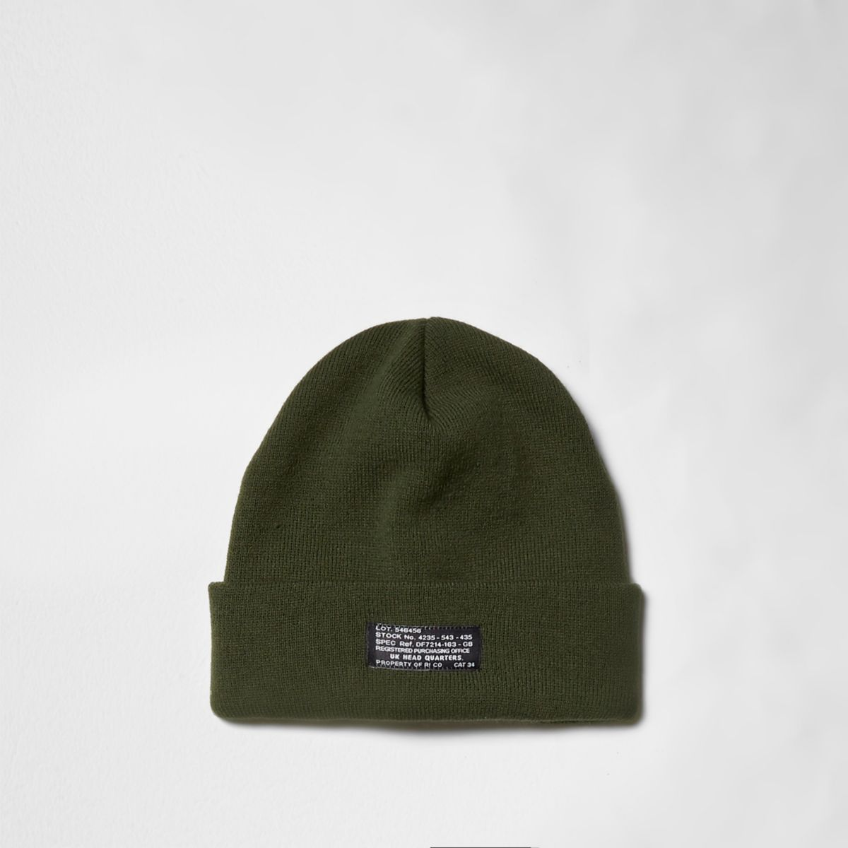 Green knit rolled up beanie hat