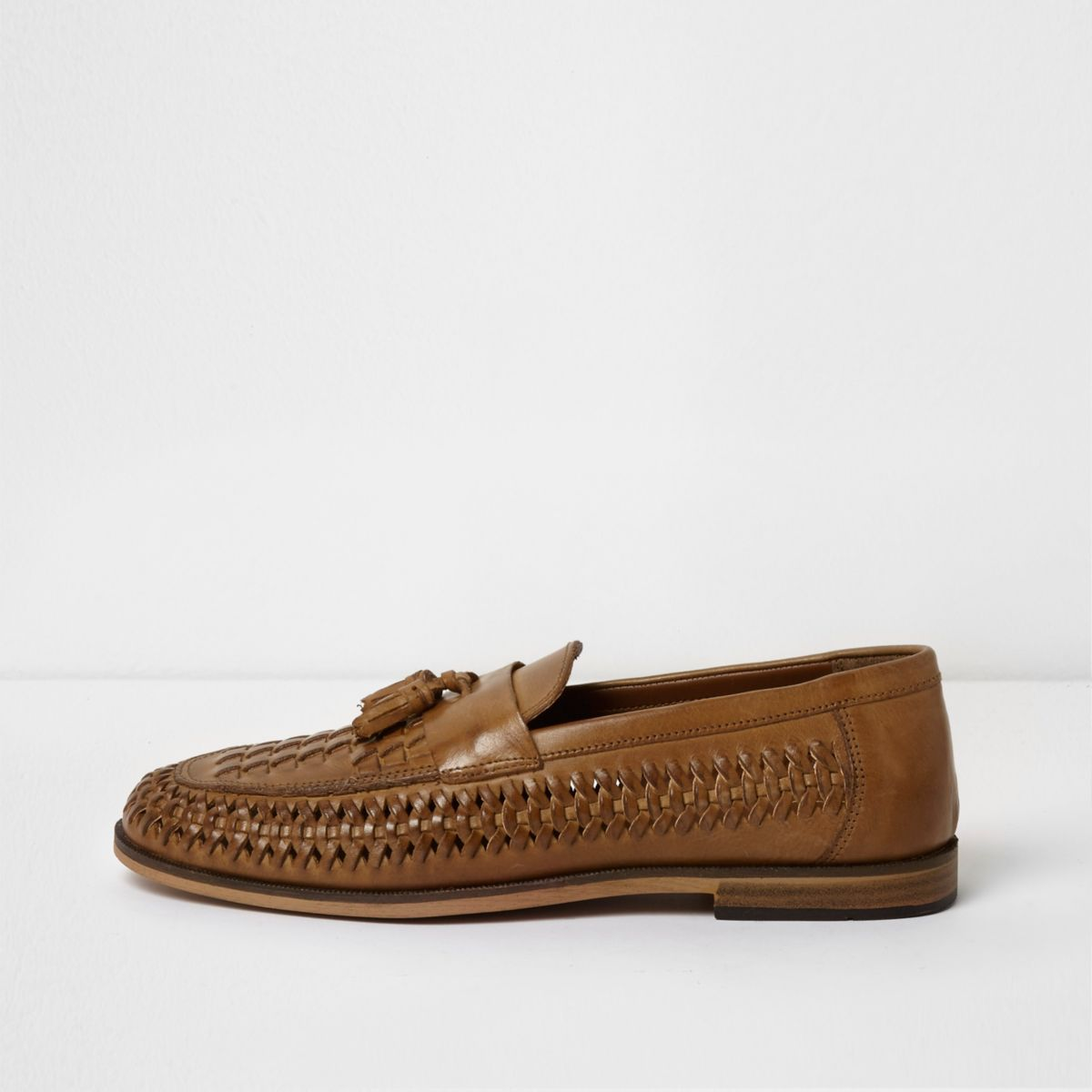 Tan polished leather woven tassel loafers