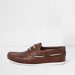 Tan brown leather lace-up boat shoes