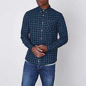 Chemise à carreaux bleu marine avec manches longues et boutons