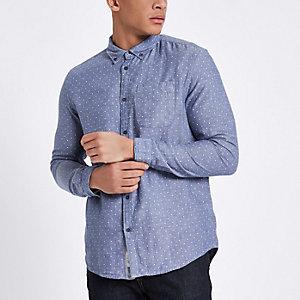 Lichtblauw overhemd met lange mouwen en stippen