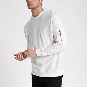 Sweat blanc avec manche à poche zippée