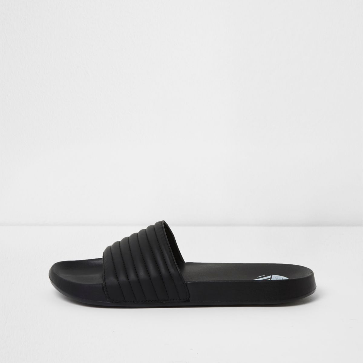 Black quilted sliders