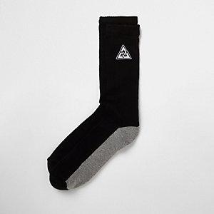Chaussettes tubes noires avec triangles brodés