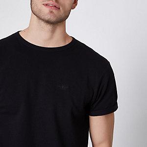Zwart aansluitend piqué T-shirt met ronde hals