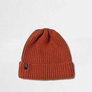 Dark orange ribbed knit beanie hat