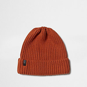 Dark orange ribbed knit beanie hat