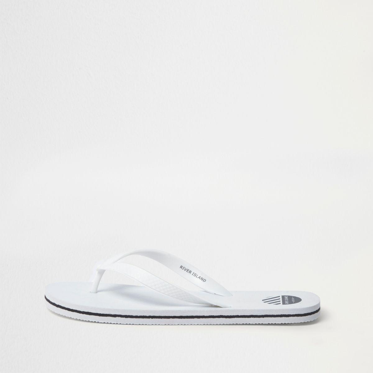 White textured flip flops
