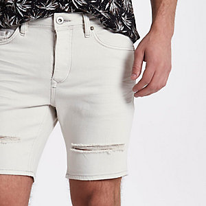 Cream slim fit ripped denim shorts