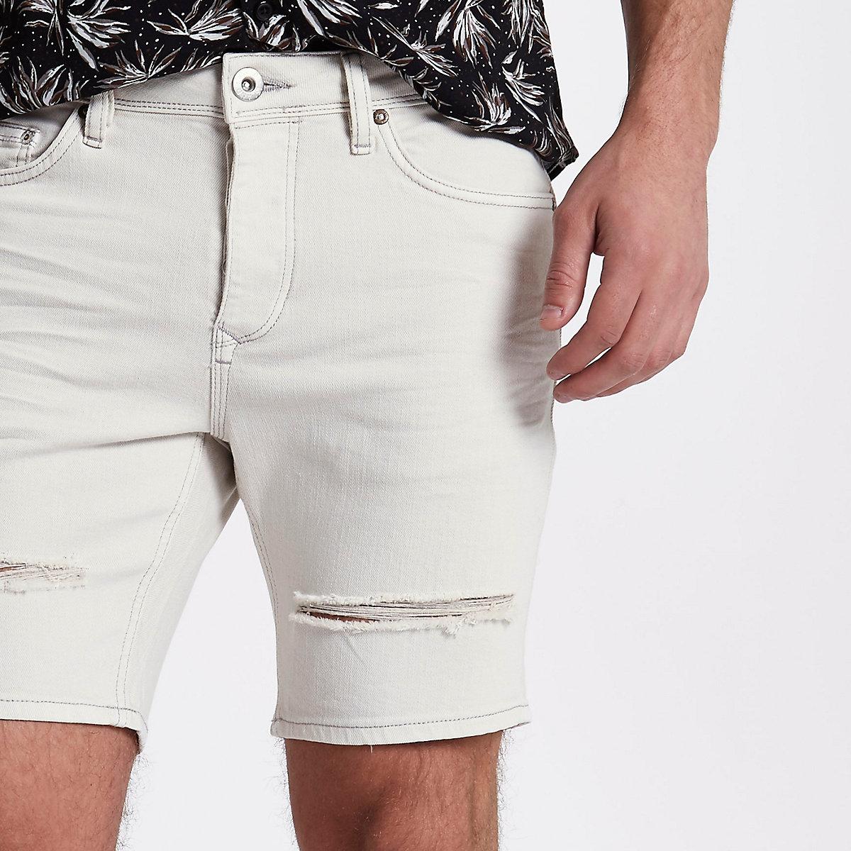 Cream slim fit ripped denim shorts