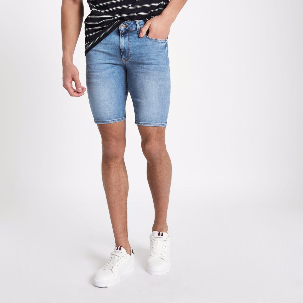 Light blue spray on skinny denim shorts