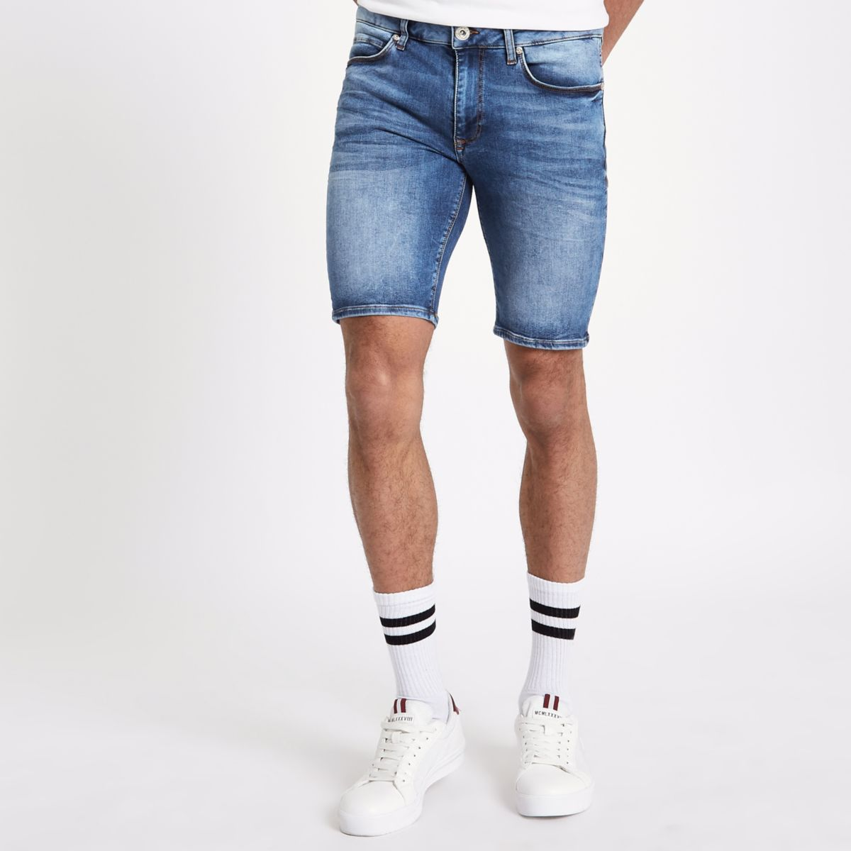 Mid blue spray on skinny denim shorts