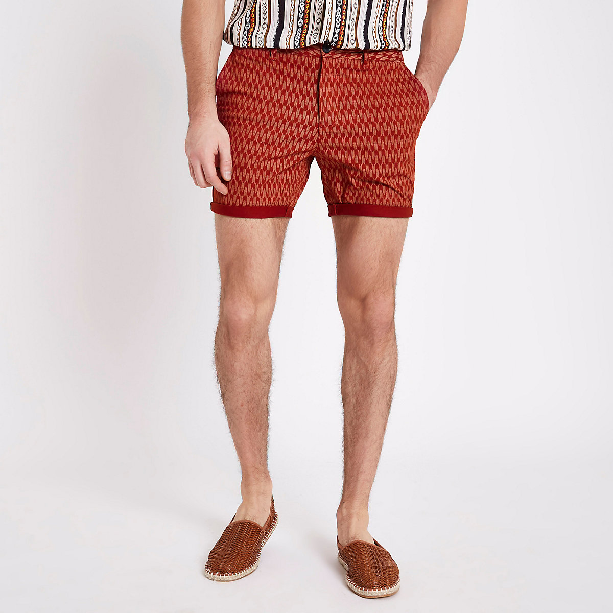 Red textured tile print shorts