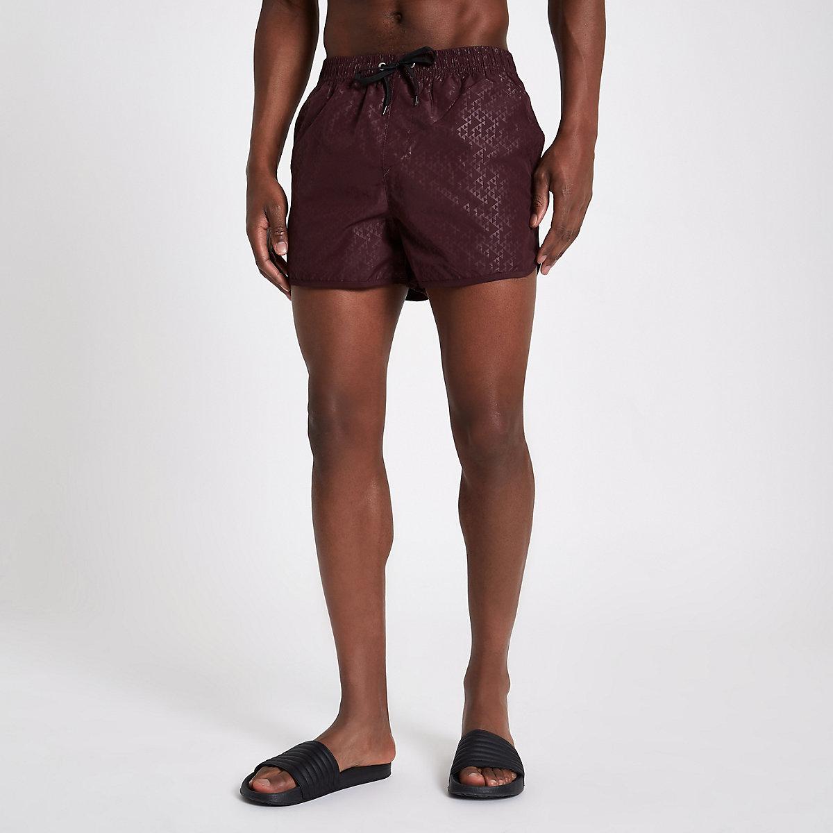 Burgundy triangle embossed runner swim trunks