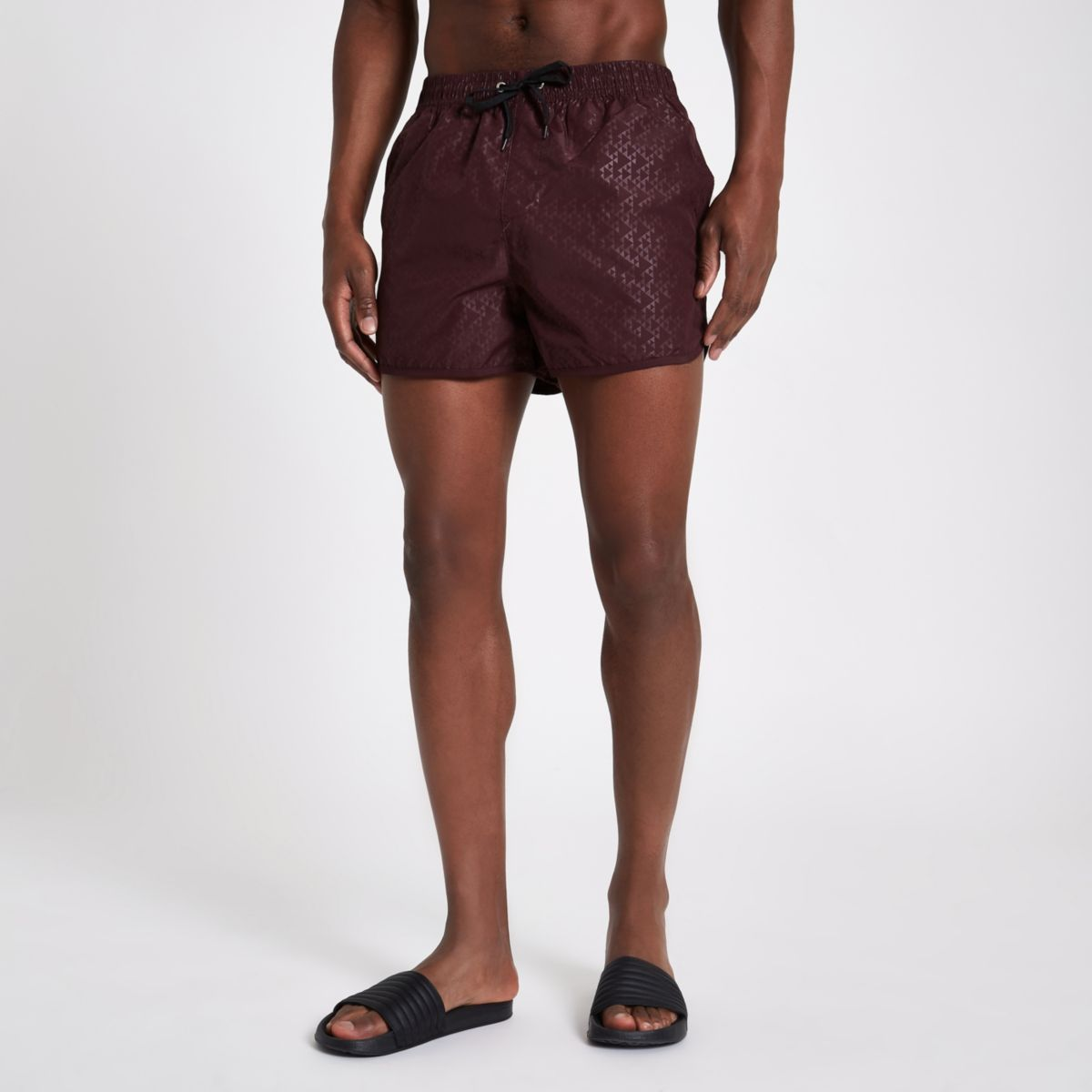 Burgundy triangle embossed runner swim shorts