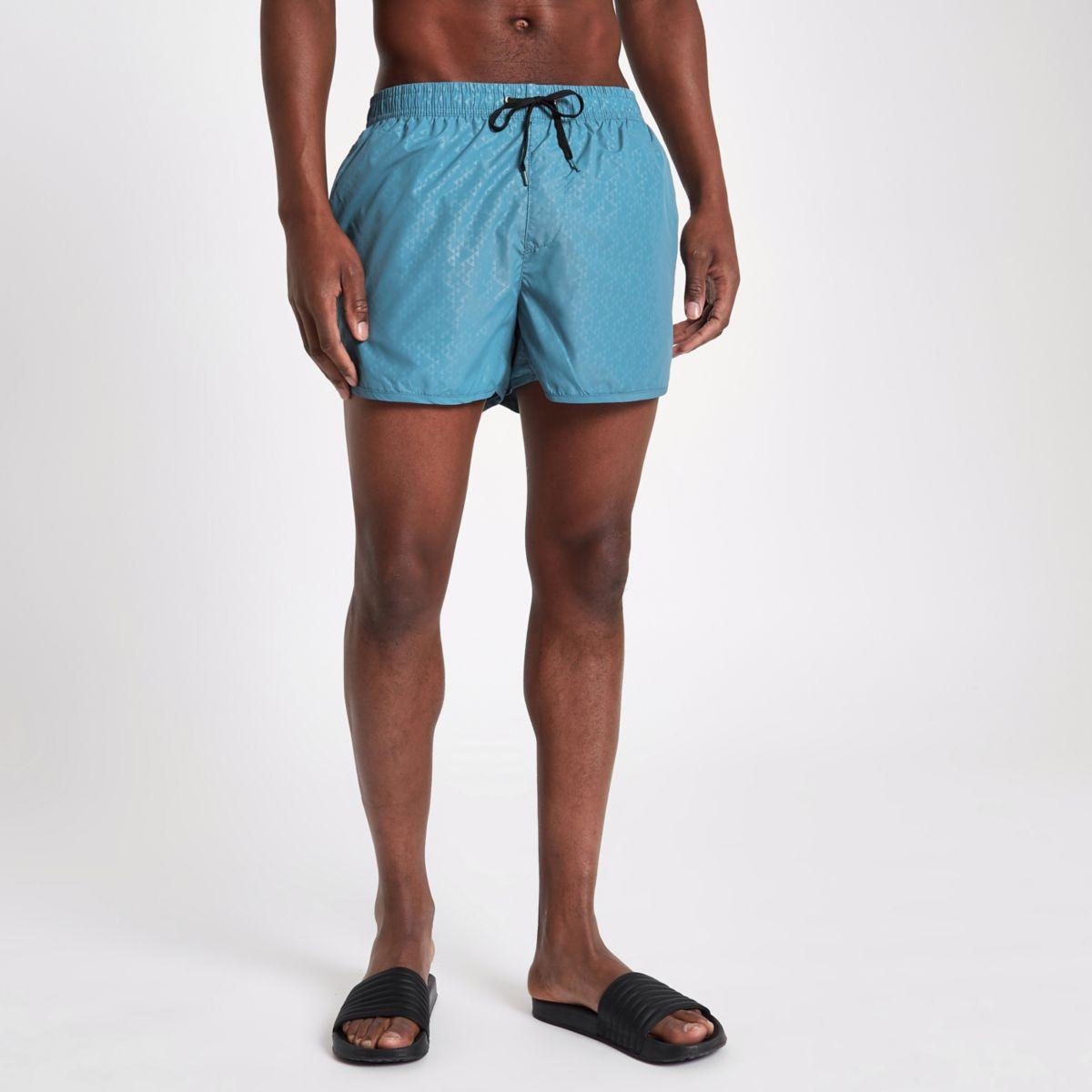 Blue triangle embossed runner swim trunks