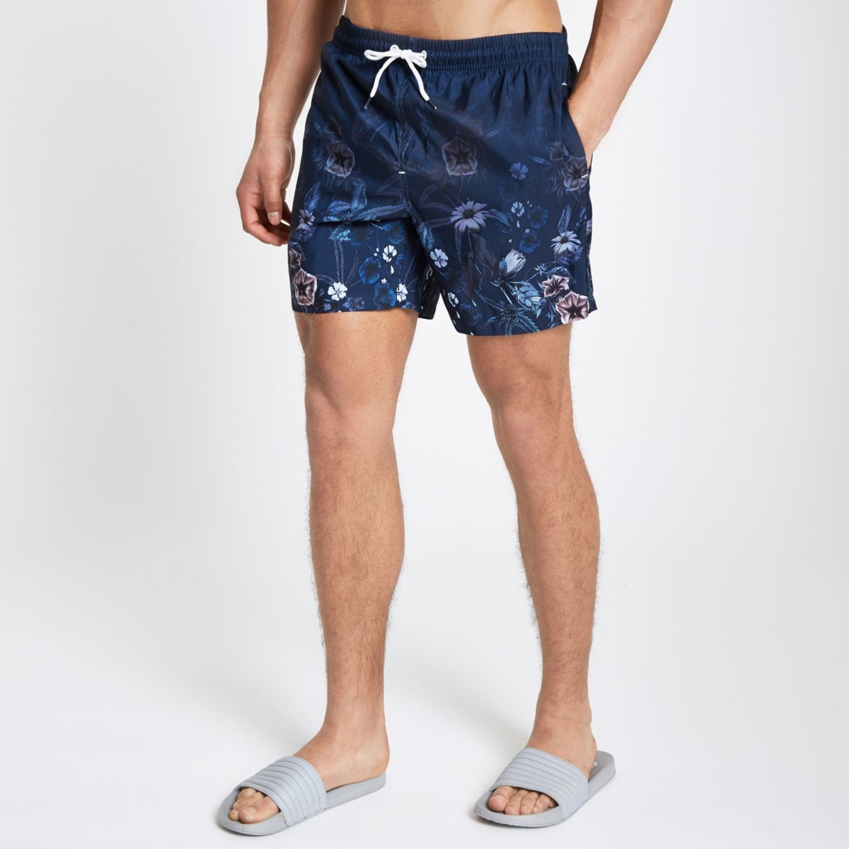 Navy floral fade swim shorts