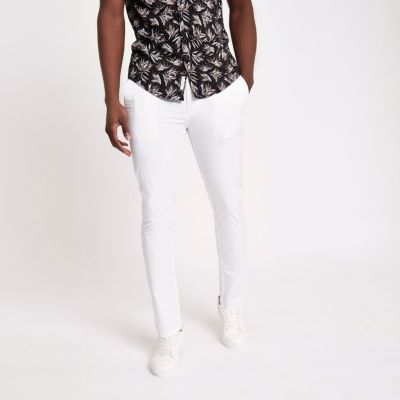 White skinny chino trousers White skinny chino trousers ...