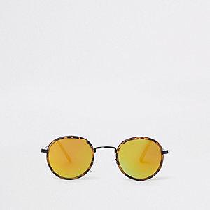 Bruine zonnebril met schildpadmotief en gele glazen