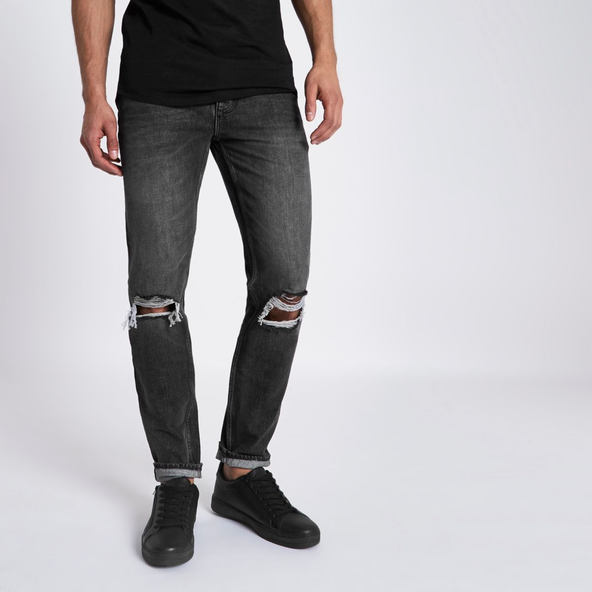 Schwarze, dehnbare Skinny Jeans im Used Look