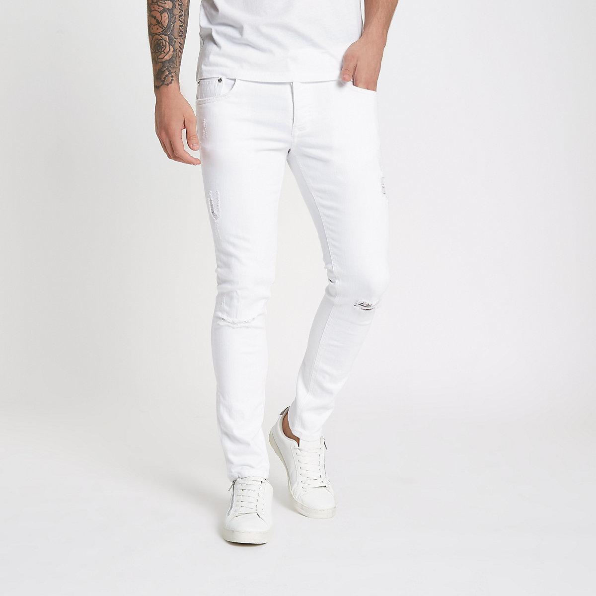 White Eddy ripped knee skinny jeans