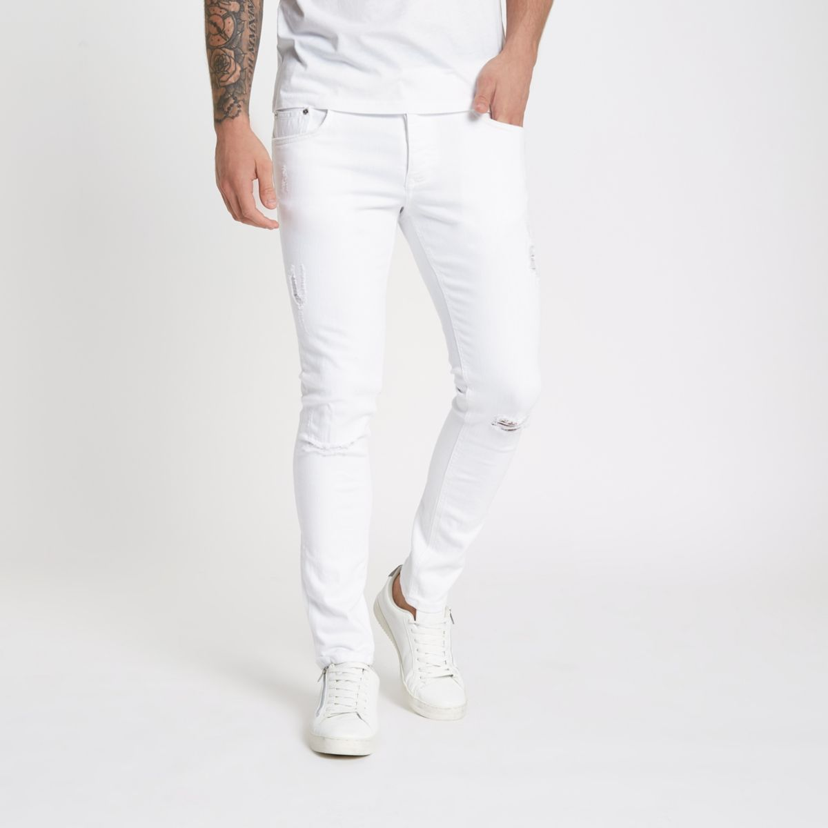 White Eddy ripped knee skinny jeans