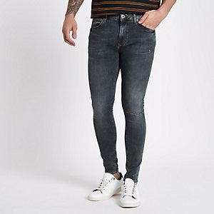 Jean bleu foncé super skinny délavé irrégulièrement