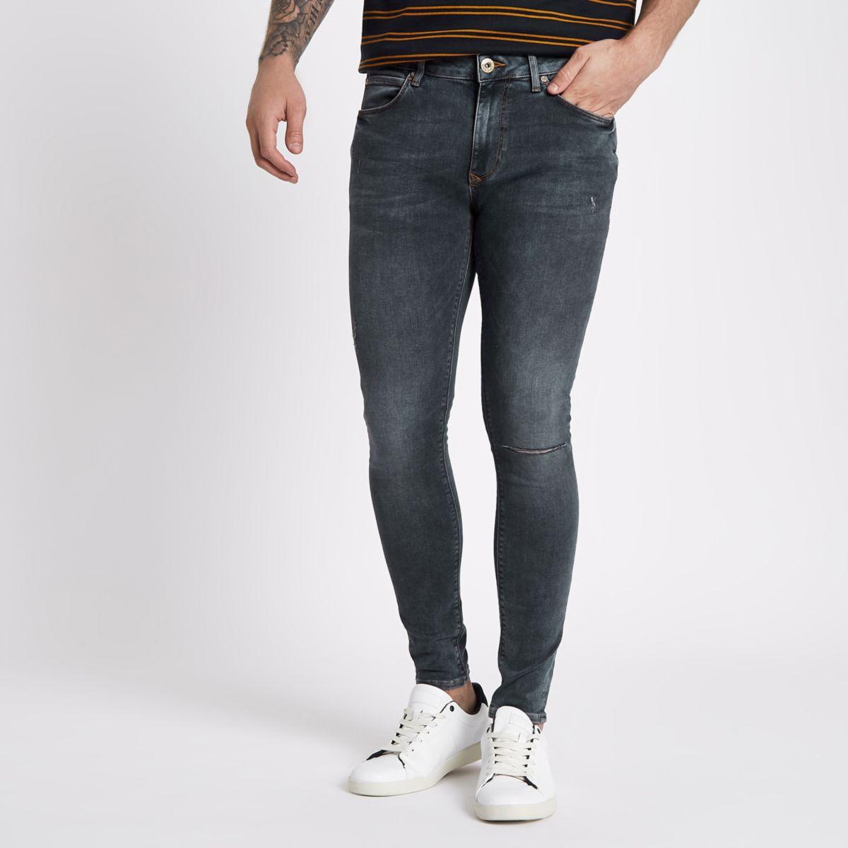 Dark blue super skinny spray on jeans
