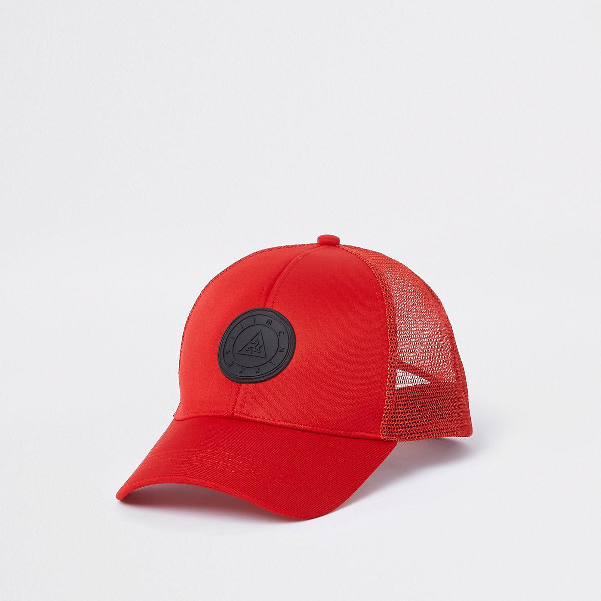 Red badge trucker cap