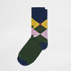 Grüne, verzierte Socken mit Argyle-muster