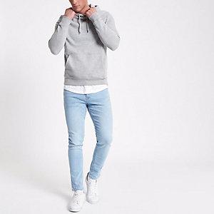 Jean skinny à délavage bleu clair