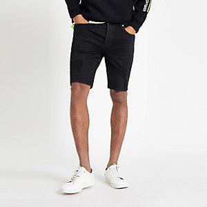 Short skinny en jean noir délavé déchiré