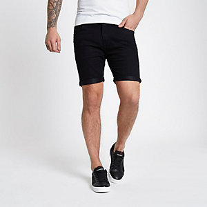 Lee – Short en denim noir à revers