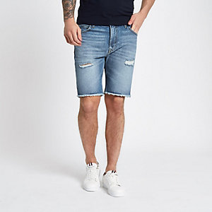 Lee – Short en denim bleu à bords bruts