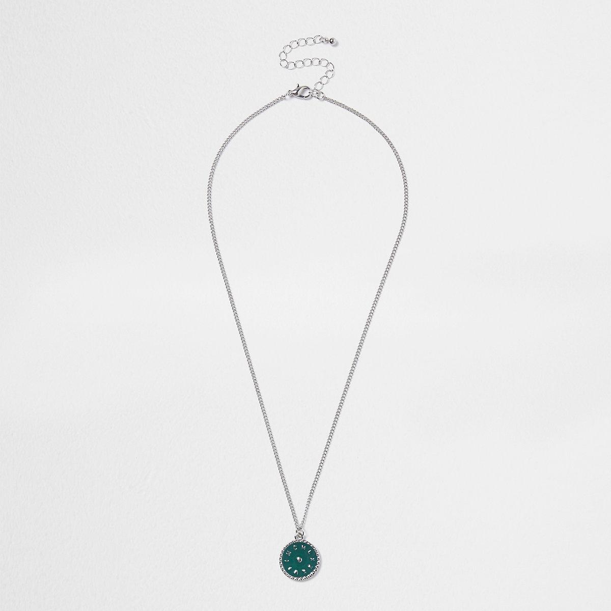 Silver tone green disc pendant necklace