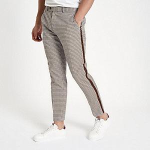 Pantalon skinny à carreaux écru avec bande latérale