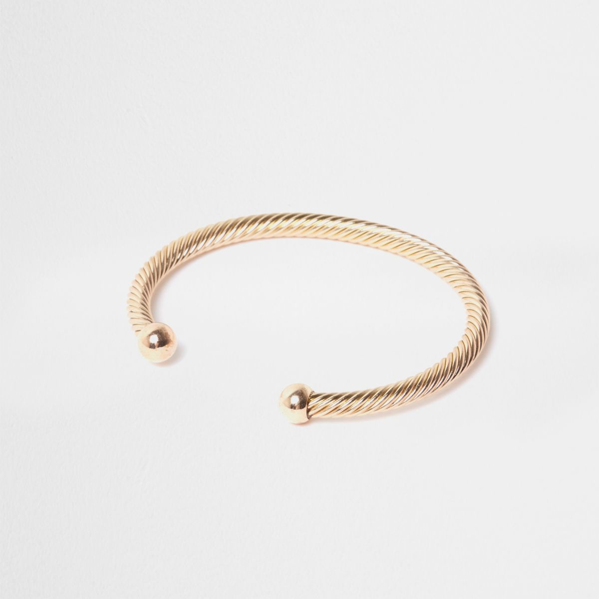 Gold tone twist cuff bracelet