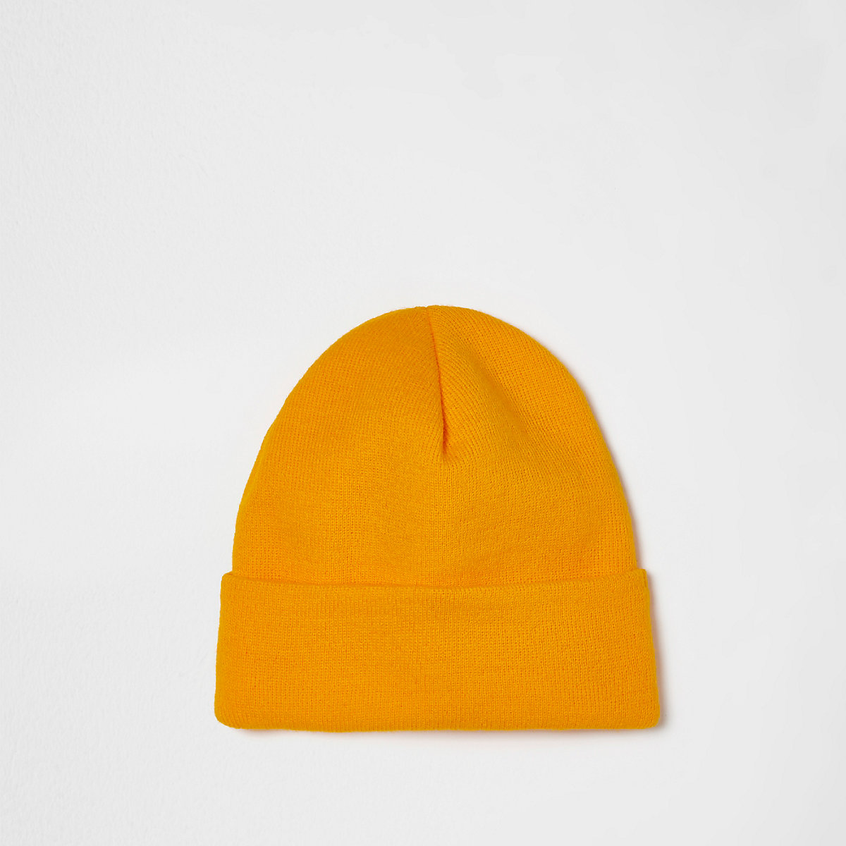 Yellow knitted beanie hat