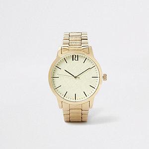 Goudkleurig horloge met RI-monogram en schakelbandje