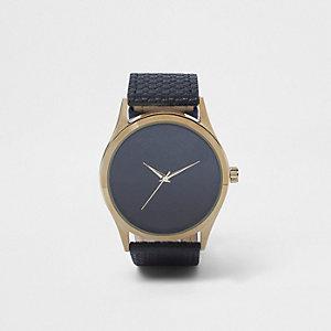 Zwart horloge met ronde wijzerplaat en RI-monogram