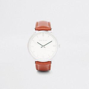 Bruin minimalistisch horloge met ronde wijzerplaat