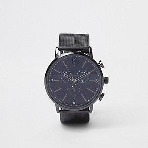 Horloge met ronde wijzerplaat en zwart bandje van mesh